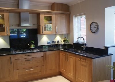 High quality kitchen with natural oak units and granite work surfaces